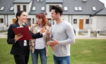 Agent with home buyers